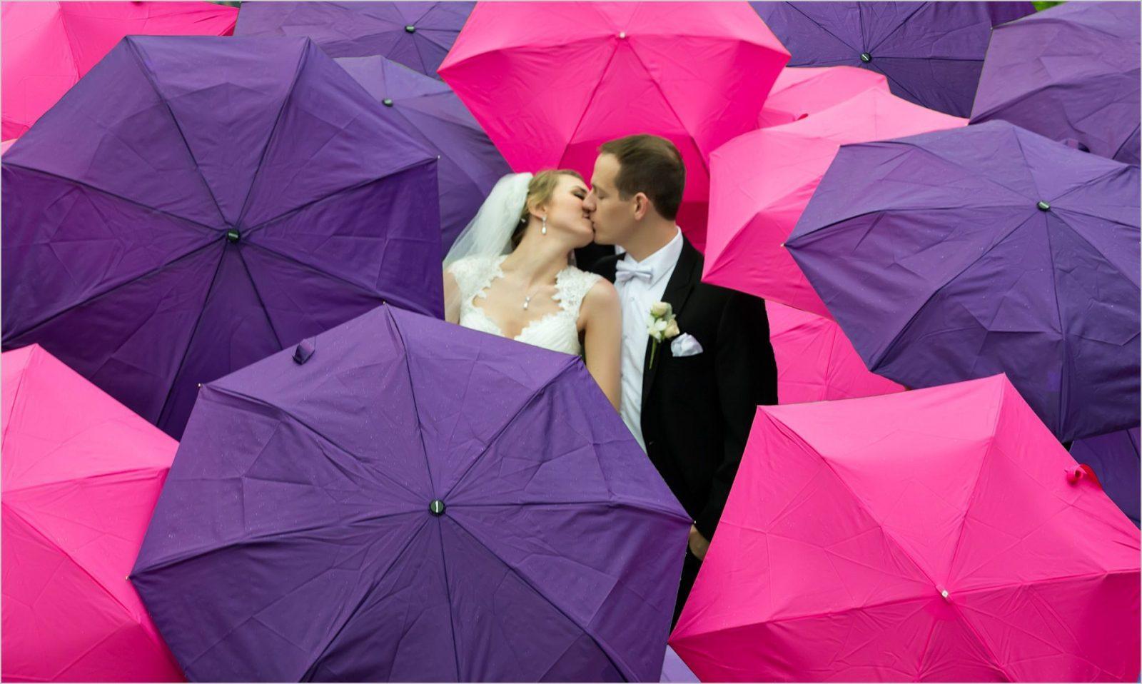 Yeatman's Cove Cincinnati Wedding bride groom rain umbrellas