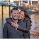 Engagement couple huggin Cincinnati skyline